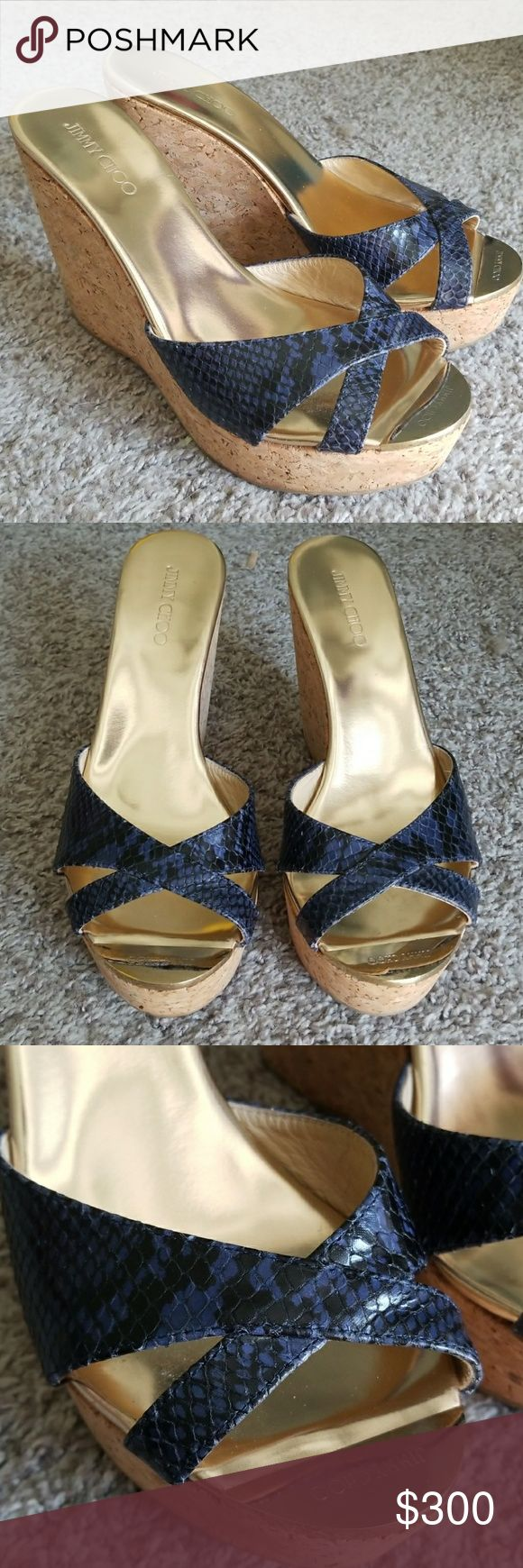 Jimmy Choo Wedges Authentic Jimmy Choo Perfume Patent Leather Crisscross Wedges Size 38 These have only been worn once! Jimmy Choo runs half a size small. Blue and black Snake Python Print. Pandora Sandals. Missing the box.  Please use the offer button for all offers! Clean, smoke free home. Jimmy Choo Shoes Wedges