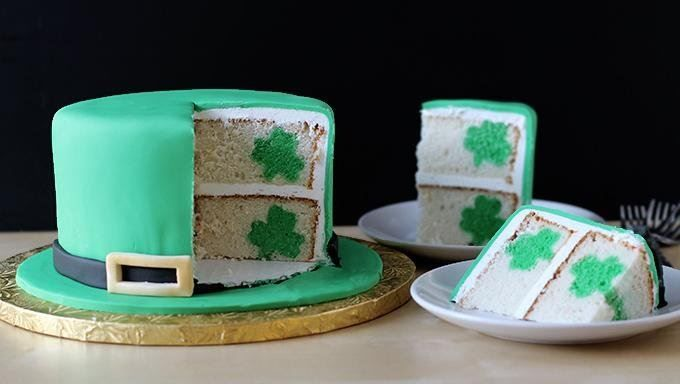 Secret shamrocks are the special surprise inside this leprechaun hat shaped reveal cake for St. Patrick's Day.