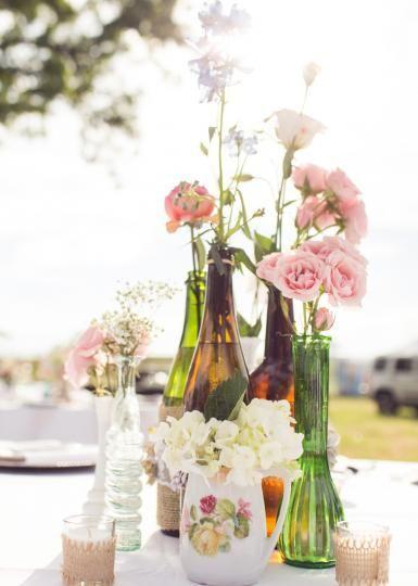 Vintage glass bottles centerpiece. Photo by Randy Coleman Photography. #wedding #centerpiece #vintage