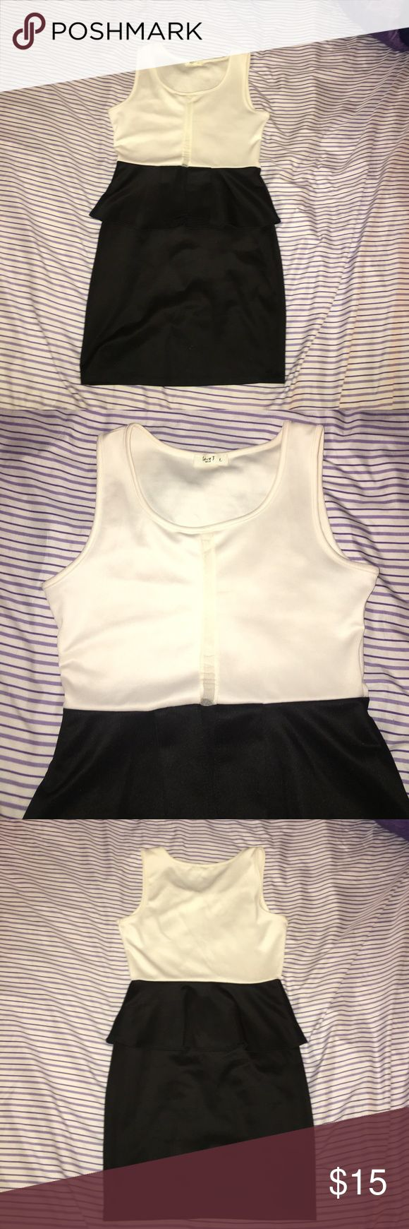 Black and White Peplum Dress This beautiful yet simple dress can be worn anywhere! Peplum dresses never go out of style and can give you that perfect hourglass silhouette shape you have always wanted. Dresses Midi