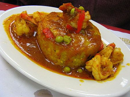 Mofongo. A Puerto Rican dish of mashed garlic plantains stuffed with pork cracklings, then often topped with meat or shrimp and a thick broth. This looks so YUMMY.