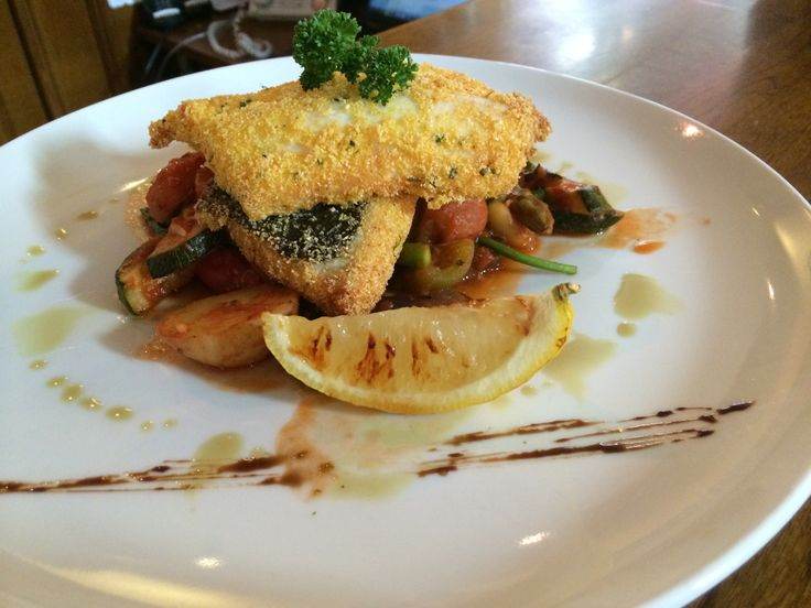 Today's special is a fillet of Plaice with a polenta crust on a bed of warm Ratatouille .