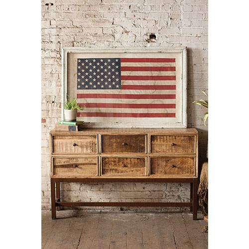 This large framed American flag adds a dose of patriotic color to an otherwise basic corner space.