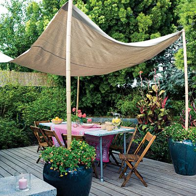 Need shade on the patio next summer! This looks easy-peasy & I love the tent on bamboo poles anchored in great big pots with plants.