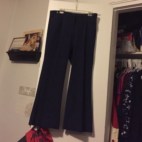 Size 12 wide leg navy blue dress pants New York and Company wide leg dress pants.  Lightly worn very comfortable navy blue dress pants.  These have been hemmed because I am short but no material was cut.  Will take hem out.  Great looking pants New York & Company Pants