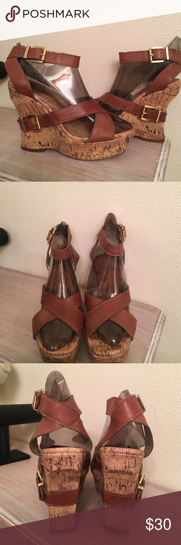 Jessica Simpson sandals Cute wedge shoes worn once.  They have adjustable ankle strap with cute buckle detail on cork wedge.  Wedge is 5 inches with 1 inch platform on the front. Jessica Simpson Shoes Sandals