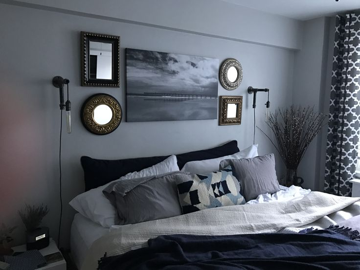 DIY industrial piping sconces and bed pillow converted to headboard