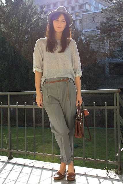 Classic Style | Grey pleated trousers with cuffs, oversized light grey top, grey felt hat, brown loafers, belt, and bag