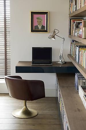 A cantilevered, floating desk, adds instant architectural interest to this space- elevate the style quotient at your work space and be more inspired!