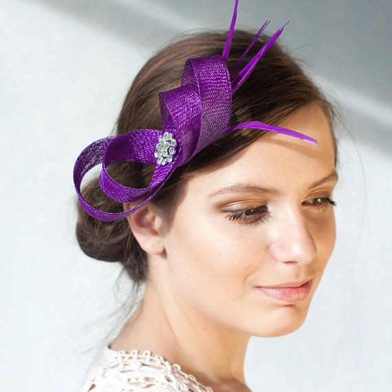 Hey, I found this really awesome Etsy listing at http://www.etsy.com/listing/126595002/fascinator-with-feathers-sinamay-loops