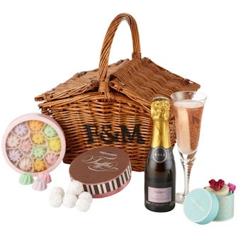 The Ladies' Favourite Basket - Fortnum & Mason.      Every lady's favourites must surely include some of the contents of this basket: pink Marc de Champagne Truffles, crystallised sweets, rose-scented soap and a helping of pink champagne. Pretty, elegant and beautifully presented, it would make a charming gift for any occasion.