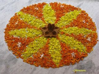A simple Rangoli for Diwali made with real flower petals, this would be easy to create with small children