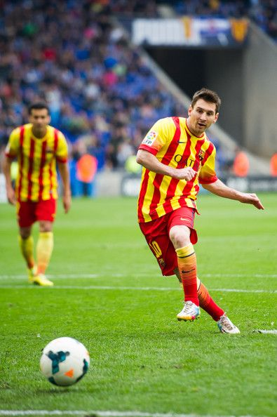 Lionel Messi of FC Barcelona scores the opening goal with a penalty during the La Liga match between RCD Espanyol and FC Barcelona at Cornella-El Prat Stadium on March 29, 2014 in Barcelona, Catalonia.
