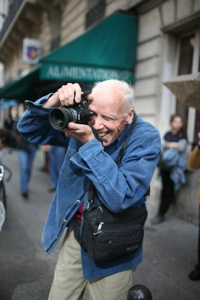 Bill Cunningham capturing street style at #NYFW