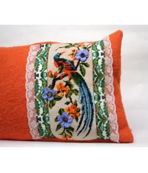 This pillow cover is made of vintage embroidery and a woolen blanket. The cushion is decorated with floral fabric, ribbon and silk flowers.