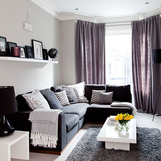 Want living room design ideas? Take a look at this beautiful grey living room with purple soft furnishings for inspiration