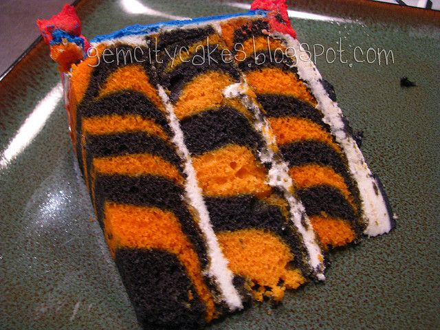 Tiger Cake Slice by gemcitykitty, via Flickr. Maybe shark decorations with Tiger interior!