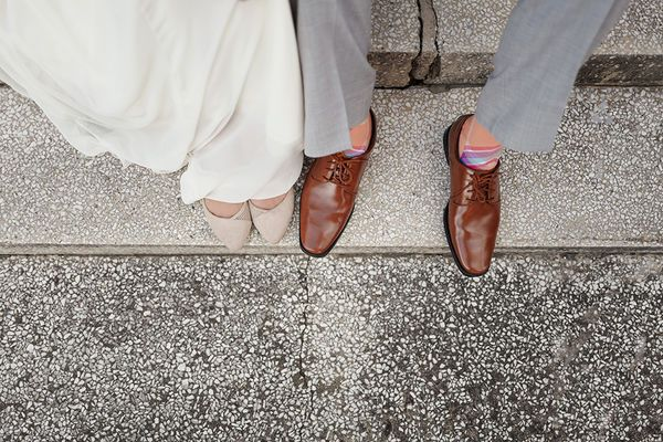 Cute wedding photo of the bride and groom's feet.