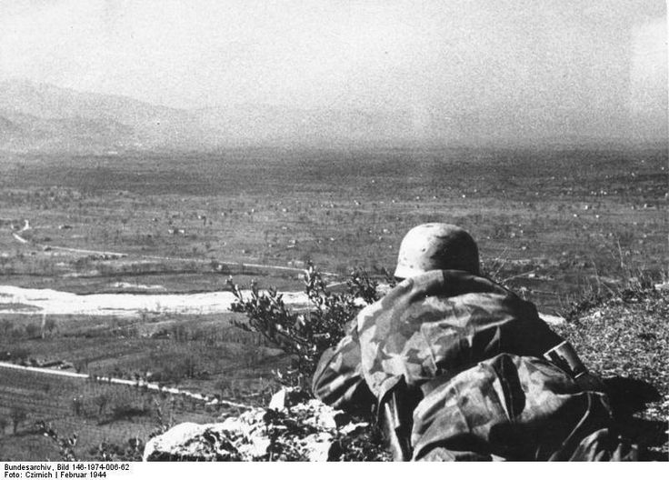 German paratrooper observing lower ground from Monte Cassino, Italy, Feb 1944.