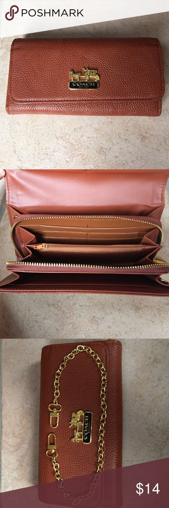 Faux Coach Wallet with Chain Faux Coach wallet with 12 pockets for cards that has never been used or worn. Zipper to close inside pockets and additional chain to convert it to a handbag! Faux Coach Bags Wallets