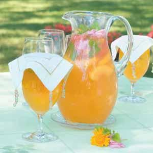 Peachy Lemonade Recipe*** Ingredients:  8 cups lemonade*  2 cans (5-1/2 ounces each) peach nectar or apricot nectar*  1 cup frozen unsweetened sliced peaches*  Fresh mint sprigs, snapdragons and lemon balm ***Prep: 10 min. + chilling Yield: 10 Servings