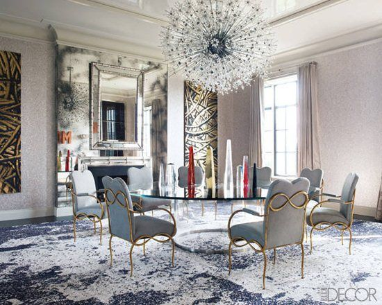 The mirrored surfaces take center stage in this goreous dining room. Click through for more tips on designing with mirrors. Image credit: Elle Decor