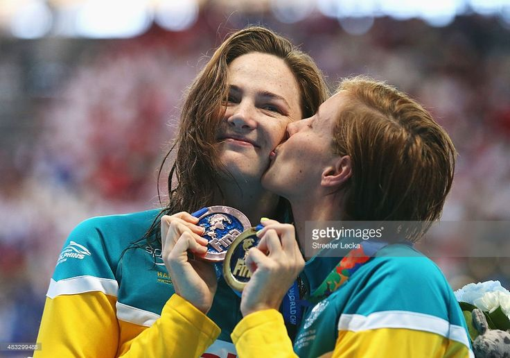 Gold medalist Bronte Campbell (R) of Australia kisses her sister and bronze…