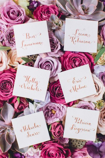 Place cards on a bed of stunning flowers: http://www.stylemepretty.com/2014/08/25/rustic-elegance-wedding-inspiration/ | Photography: Bradley James - http://www.bradleyjamesphotography.com/