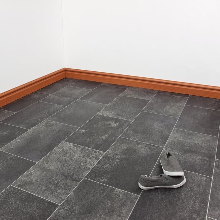 Our Monarch Classic vinyl has it all in the name. Regal, classic tiles, with an embossed effect. All the beauty of good tiles without the cost and the hassle. Perfect for kitchens and bathrooms, our vinyl flooring is water resistant, durable, and cushioned for comfort, sound dampening, and insulation.