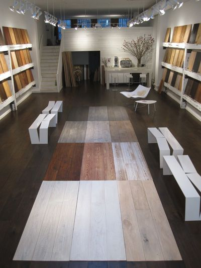LV Wood Floors Showroom in NYC. Espresso bar at rear is freestanding, white,