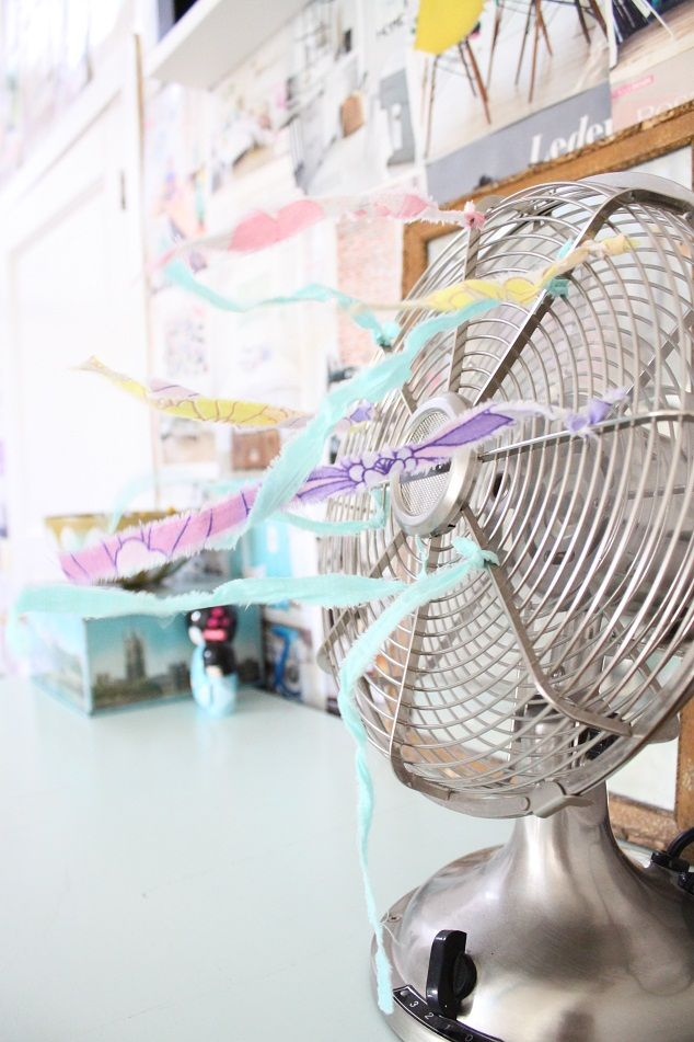 torn fabric strips on the fan -- pretty for summer