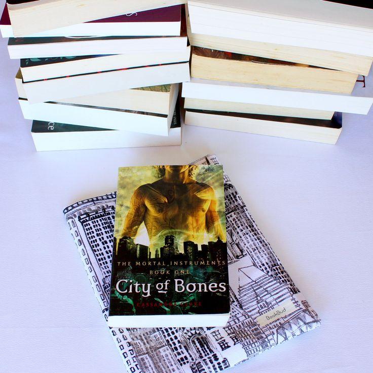 Cityscape book sleeve from BookBud. https://www.etsy.com/au/shop/BookBudByGabrielLea?ref=hdr_shop_menu