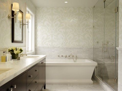 marble subway tile wainscoting and mosaic tiles above crating a striking yet subtle