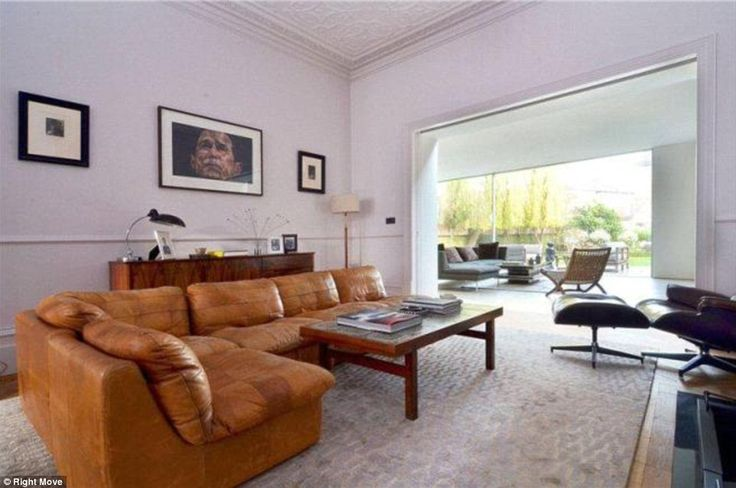 In a 2010 interview the radio personality revealed how he had bought his first home aged 21 in trendy Notting Hill and by his late 30s had traded up by moving four times. Pictured: A living room at the star's five bedroom, west London home