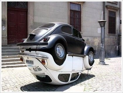 The monument to Volkswagen Beetle is in Rio de Janeiro, Brazil. Production of Volkswagen Beetle in Brazil ended in 1986, then restarted in 1993 and continued until 1996. The monument combines two Volkswagen Beetle cars.