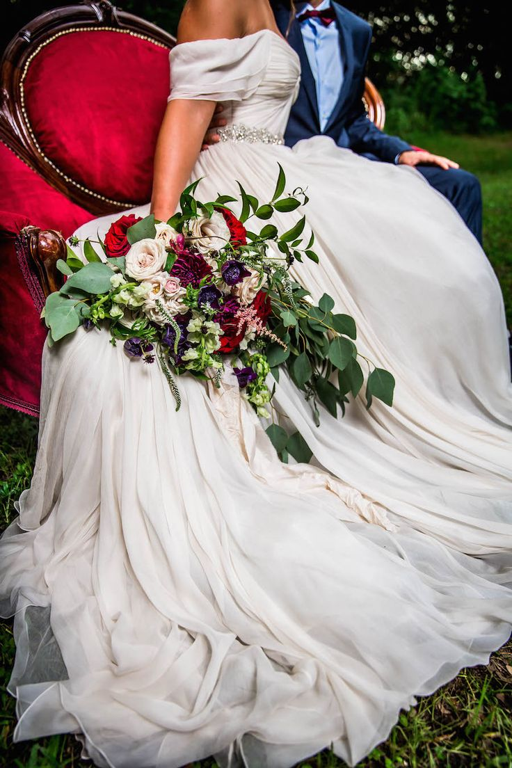 Bride in Amsale Wedding Dress from Blush Bridal Sarasota with Deep Red Burgundy…