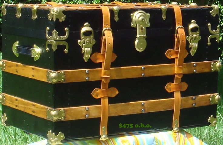 This beautifully restored jet black flat top steamer trunk with a breathtaking pine body is from the late 1800's. Complete with steel hardware, authentic leather straps with buckles and hardwood slats. I have accented it with gold to really bring out the black.