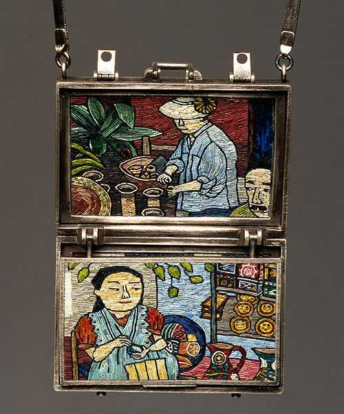 """Cynthia Toops  """"Trip – Mexico"""". The pendant's polymer clay panels are reminiscent of postcards and are secured in a sterling silver """"suitcase"""" , inset, made by Chuck Domitrovich. Photo by Roger Schreiber"""