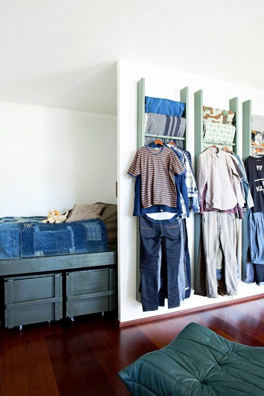 25 DIY Projects for Small Bedrooms -- Not sure how functional it is, but I like this idea of storing blankets (and potentially clothes) on wall-mounted racks/ladders.