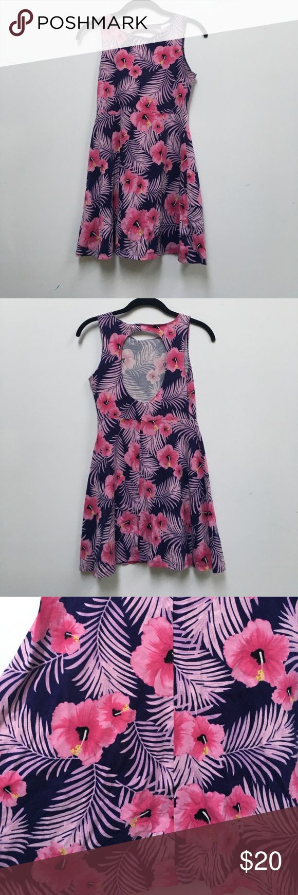 Victoria's Secret pink sundress Adorable and comfortable sundress. Purple with pink Hawaiian style flowers and leaves. Fit and flare with a open back circular cutout. Excellent condition PINK Victoria's Secret Dresses Backless
