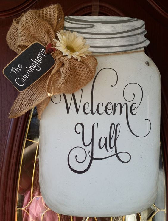 Welcome your friends and family with this wooden Mason Jar door hanging. The jar measures 19 tall x 11 1/2 wide and is made of 1/8 birch plywood. The