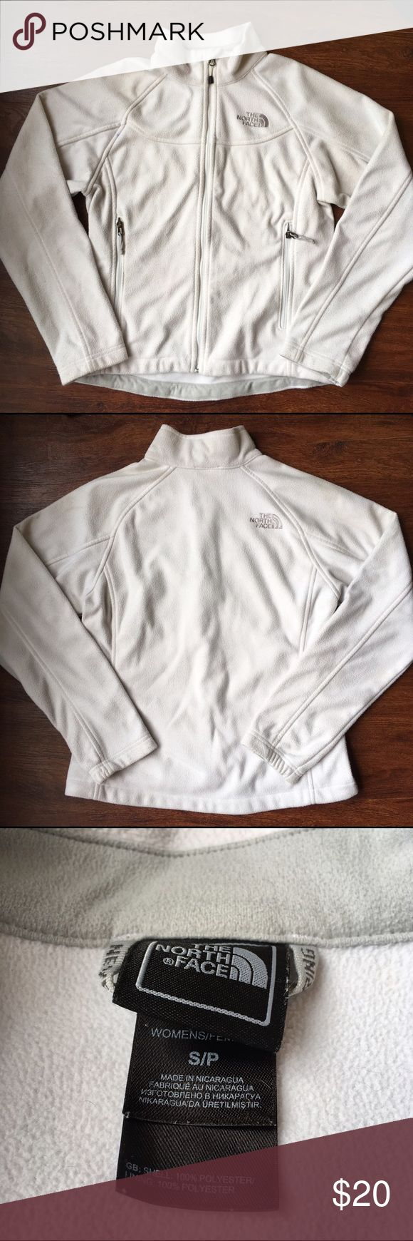 White North Face Jacket There are a few small stains and on some parts of the sleeves the fabric has become a less bright white color, other than that it's in good condition. 100% Polyester The North Face Jackets & Coats Utility Jackets
