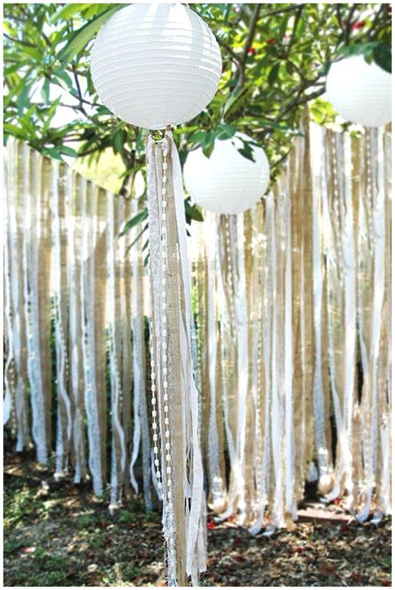 Hanging paper lanterns and ribbon, burlap, lace and bead streamers /  http://www.himisspuff.com/100-charming-paper-lantern-wedding-ideas/3/