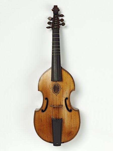 "1667 English Tenor viol at the Victoria and Albert Museum, London - From the curators' comments: ""Viols, which came in a number of different sizes ranging from treble to bass, were held between the legs, hence the term viola da gamba, and played with a bow that was held with the palm of the hand turned outwards. This limited the pressure brought to bear on the string and created a softer sound than that made by the violin. By about 1780 viols were almost entirely replaced by violins and…"