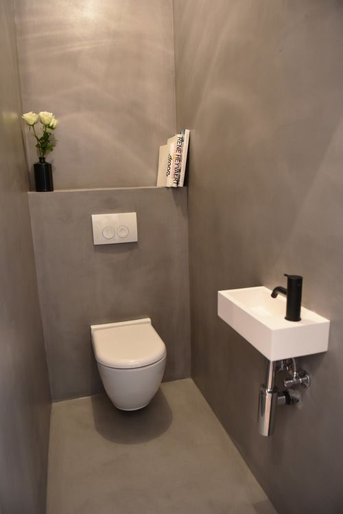Toilet in Grey Betonciré and White Corian Sink