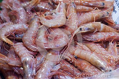 Shrimp in fish market Close up of fresh whole raw shrimp or prawns on display in fish market. Photo taken on: October 29th, 2016