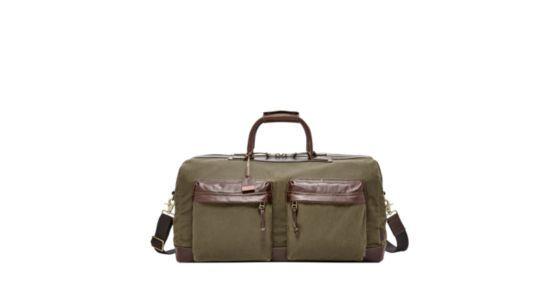 Unsere Reisetasche aus gewachstem Canvas ist praktisch, schick und auf den Lederanhänger kannst Du Deine Initialen prägen lassen.