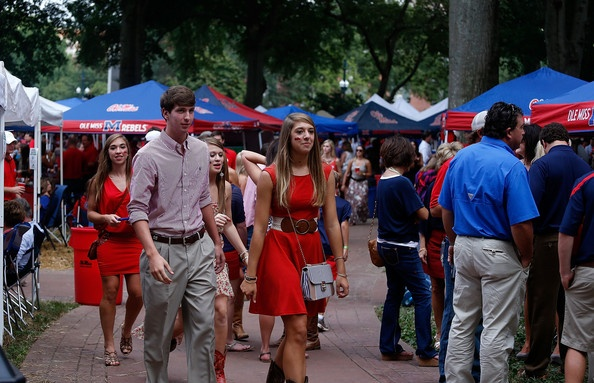 At Ole Miss home games, well-dressed ladies and gents cram the Grove for a full 24 hours of serious tailgating.
