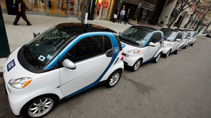Car2Go vehicles lined up in Washington, D.C., as the company prepared to launch service there last year. The car sharing service is also in Europe and other American cities, including Seattle; Austin, Texas; Miami; and Portland, Ore.