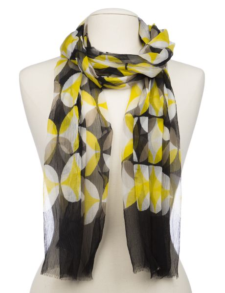 This beautiful lightweight scarf features circle prints in yellow and black. #NewandNow